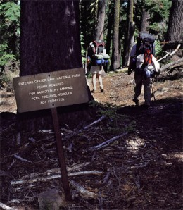 Sign designating the boundary into Crater Lake National Park.