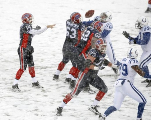 Buffalo Bills quarterback Ryan Fitzpatrick (14) passes against the Indianapolis Colts during the first half of an NFL football game in Orchard Park, N.Y., on Sunday, Jan. 3, 2010. The Bills won, 30-7. (AP Photo/Mike Groll)