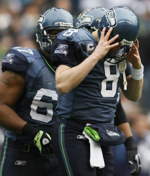 Seattle Seahawks quarterback Matt Hasselbeck (8) reacts to being sacked in the first half against the Tennessee Titans, Sunday, Jan. 3, 2010, during an NFL football game in Seattle. The Titans defeated the Seahawks 17-13. (AP Photo/John Froschauer)
