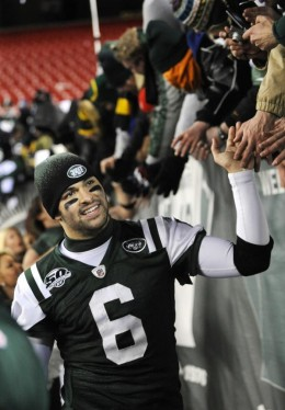 New York Jets quarterback Mark Sanchez greets fans after the Jets beat the Cincinnati Bengals 37-0 in an NFL football game at Giants Stadium in East Rutherford, N.J., Sunday, Jan. 3, 2010. The Jets won 37-0. (AP Photo/Bill Kostroun)