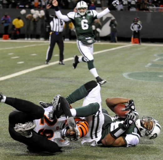 New York Jets Brad Smith, right, scores a touchdown past Cincinnati Bengals' Leon Hall as celebrating quarterback Mark Sanchez approaches during the second quarter of an NFL football game at Giants Stadium in East Rutherford, N.J., Sunday, Jan. 3, 20
