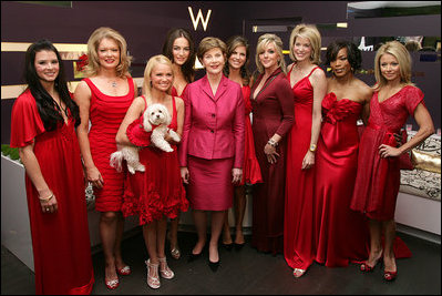 Former first Lady Laura Bush poses with celebrities in the Red Dress Collection Celebrity Fashion Show Friday, Feb. 2, 2007 to combat heart disease. (Photos public domain.)