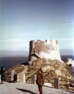 Standing below a Nuraghi