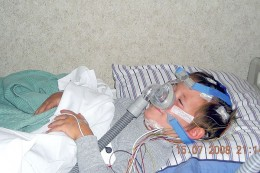 Child with CPAP device