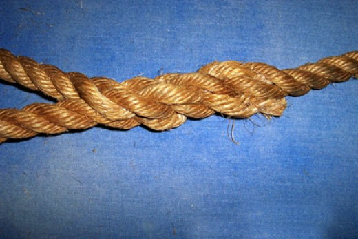 Twist open the strands of the shaft again and push each end strand over the adjacent shaft strand and under the next one.  Do all three and you've finished the splice.