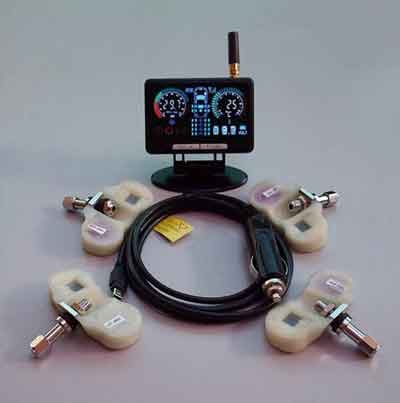 A typical tire pressure monitoring system: Four sensors, communication cable & power adaptor, and monitor