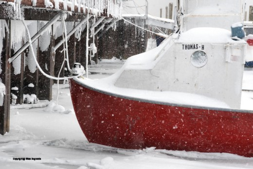 The Whitefish Point Harbor of Refuge south of the point on M-123 is frozen solid, trapping the tribal fishing boats left to overwinter at their moorings.
