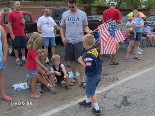 A fourth of July Parade, giving out candy to the kids