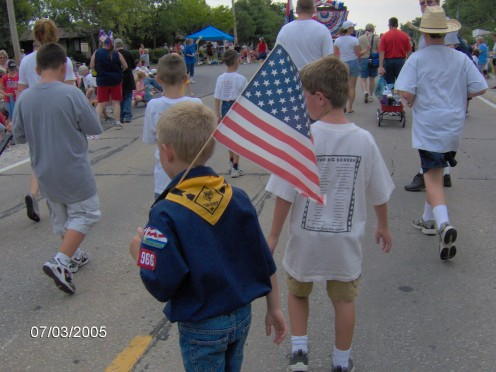 Boy Scouts marching in a Fourth of July Parade.