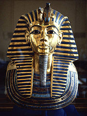 Gold burial mask of Tutankhamun, inlaid with turquoise, lapis lazuli, carnelian and coloured glass - wikimedia.commons