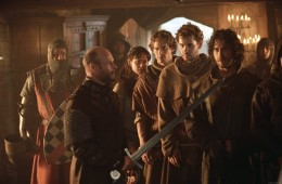 """Chris Johnston and the professor's team encounter Lord Oliver who is distrustful of strangers. Scene from the movie """"Timeline""""."""