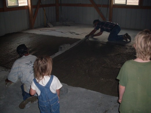 The men don't have to use a whole lot of their own power with this screed, as it is a power screed. But they do need to be watchful and consistent, or the cement may wind up slightly humpy.