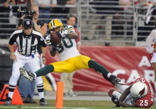 Green Bay Packers receiver Donald Driver (80) stretches for the end zone after being hit by Arizona Cardinals cornerbayc Bryant McFadden (25) during the NFC Wild Card playoff game at University of Phoenix Stadium in Glendale, Ariz. on Jan. 10, 2010.