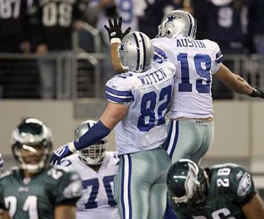 Dallas Cowboys' Miles Austin and Jason Witten celebrate Austin's second quarter touchdown against Eagles Sean Jones, right, and Joselio Hanson. Yong Kim / Staff Photographer