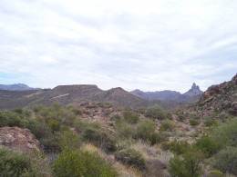 A view of the Superstitions from the inside. Two treasure hunting landmarks, Weavers Needle (extreme right) and Black-Top Mesa