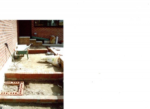 Brick Wall Raised Gardens Beds: Building The Paths and Water Tub Bases.