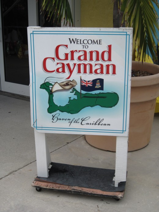 "Sign on Georgetown dock Welcoming tourists to Grand Cayman the ""Haven of the Caribbean"""