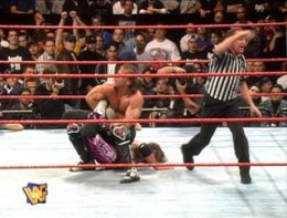 Shawn locks Bret in the Sharpshooter as ref Earl Hebner calls for the bell.