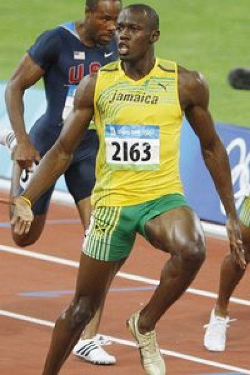 AP Photo/Mark Baker  Usain Bolt of Jamaica smashed his own record in the 100 meters despite slowing up to celebrate the gold medal he won in the process on Saturday. Beijing Olympics Usain Bolt also won the 2012 British Olympics 100 and 200 meters.