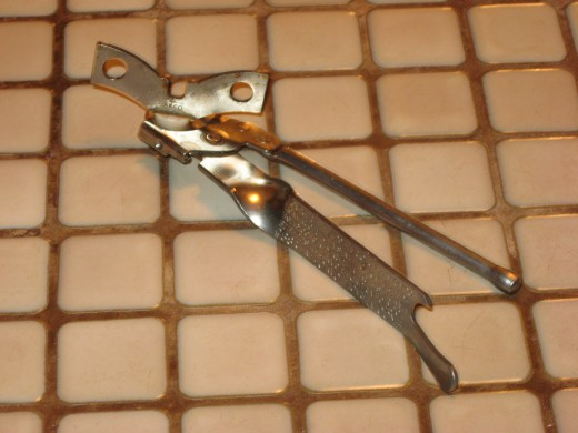 A traditional, hand-operated, can opener.