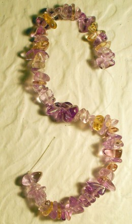 This strand 4mm Amethyst chips shows the variance of color and shape found in natural bead material.