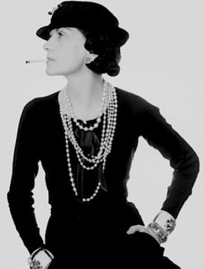 Co Co Chanel wearing her famous faux jewelry - photo courtesy of Twolia.com