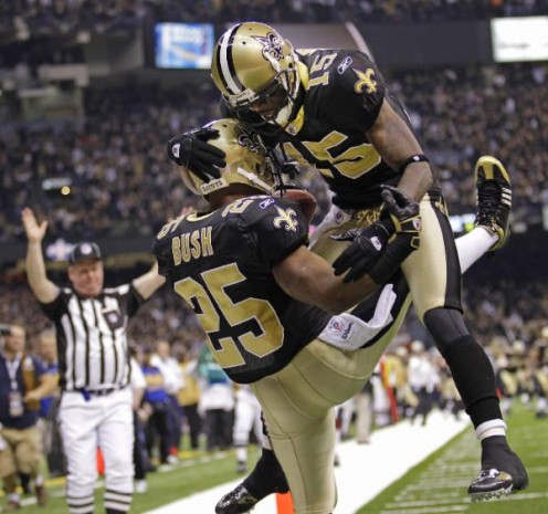 New Orleans Saints Courtney Roby celebrates with running back Reggie Bush after Bush scored on an 83-yard punt return during the third quarter of an NFL football divisional playoff game in New Orleans, Saturday, Jan. 16, 2010. (AP Photo/David J. Phil