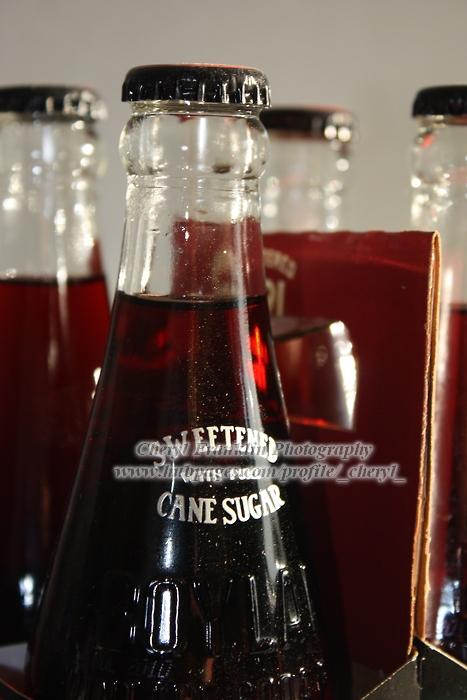 Bottles of black cherry soda stocked in our garage.