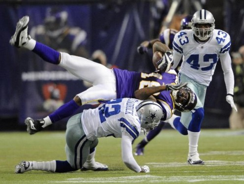 Dallas Cowboys' Orlando Scandrick (32) tackles Minnesota Vikings' Sidney Rice (18) after a catch during the second half of an NFL divisional playoff football game Sunday, Jan. 17, 2010, in Minneapolis. (AP Photo/Hannah Foslien)