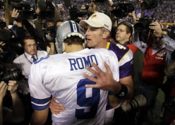 Minnesota Vikings' Brett Favre talks to Dallas Cowboys' Tony Romo (9) after the second half of an NFL divisional playoff football game Sunday, Jan. 17, 2010, in Minneapolis. The Vikings won 34-3. (AP Photo/Paul Sancya)