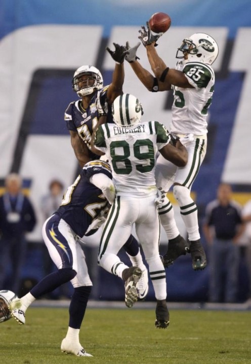 New York Jets safety Kerry Rhodes (25) reaches for an onside kick by the San Diego Chargers in the fourth quarter of an NFL divisional playoff football game, Sunday, Jan. 17, 2010, in San Diego. The Jets won 17-14. (AP Photo/Denis Poroy)