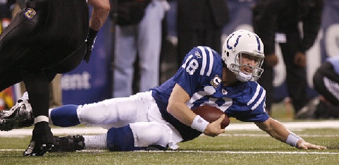 Peyton Manning slides to the turf at Lucas Field Stadium (Sam Riche/The Indianapolis Star