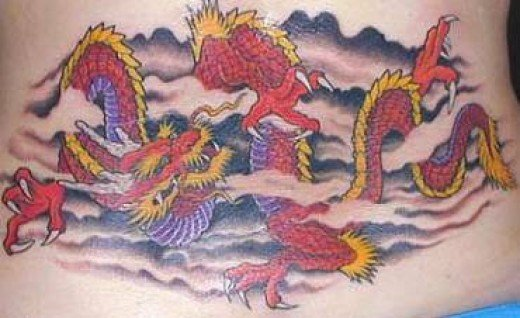 dragon tattoos so what about this stunning red dragon lower back tattoo.