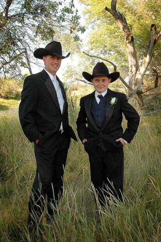 Just look how sharp these best dressed cowboys look in the proper country & western wedding attire.  No wrangler blue jeans here! Make sure that you do not sell your western wedding apparel look too short. The look of wrangler blue jeans suited up wi