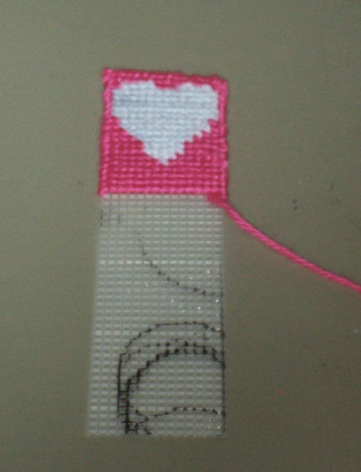 Continue using the half cross stitch technique down the length of the bookmark.
