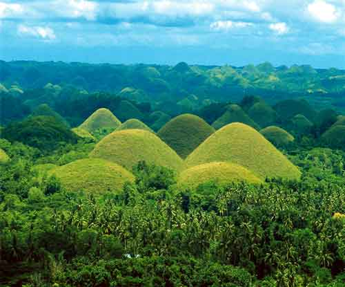 Chocolate Hills of Bohol. So named because the grasses turn brown during summer, The 1,776 mounds are one of the most popular tourist attractions in the Philippines.