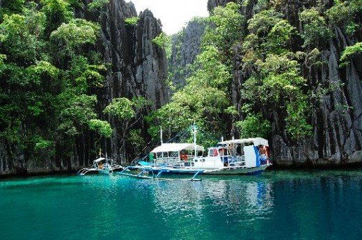 Calauit Island, Palawan. The whole island is full of scenic wonders and was declared a game preserve and wildlife sanctuary in 1977. Shown abode is the entrance to the twin lagoon, a famous swimming destination.