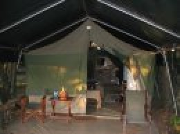A Kecheche tent with two double beds and a bathroom
