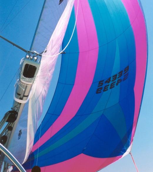Colorful sailboat sail with royal blue, aqua and bright pink