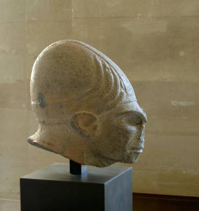 A statue of Annunaki with unusually large brain and inhumane features