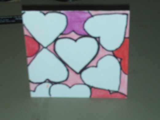 Color in the pinkish colored heart on the bottom.