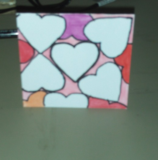 Here I colored in the orange heart at the bottom of the card.