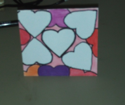 In this picture I have colored in the purple heart at the top.