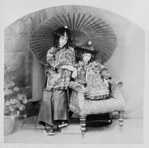 Alice and Sister Lorina dressed as Chinamen.  Photo taken by Charles Dodgson, AKA Lewis Carroll