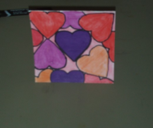 Here I have completed the card by coloring in the last two hearts with a pretty red color.