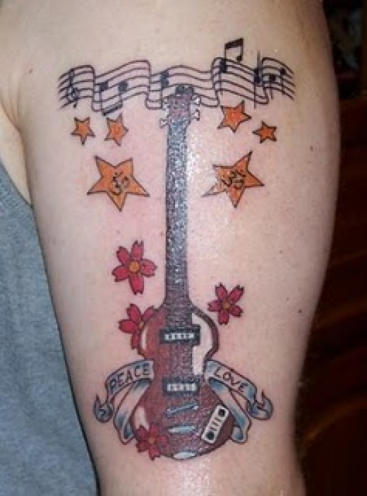 enjoys the music note tattoo designs because they are great tattoos.