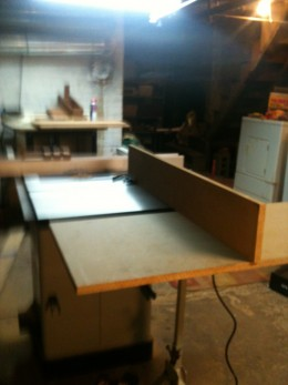 Using an outfeed support and a 2'x3' sheet of MDF makes a surprisingly stable support that's easy to bring flush with the table.