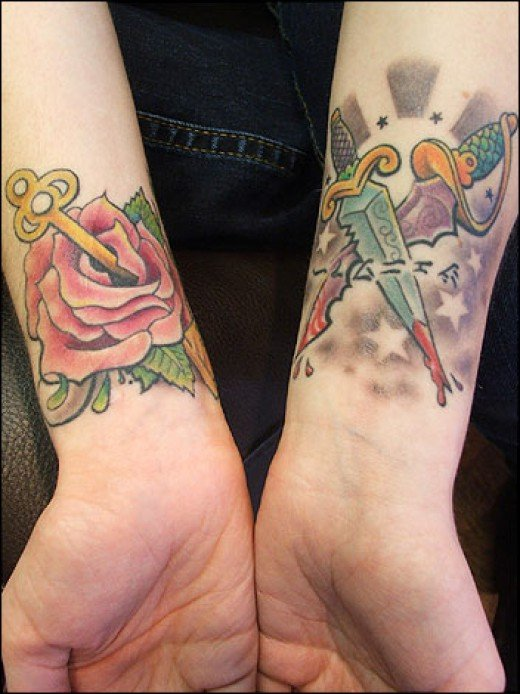 Gotta say I love the daggers wrist tattoo but for you girls a rose tattoo on