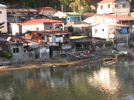 Homes along the canal near Kalaklan bridge