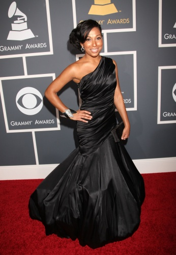 Melanie Fiona had one of the best dresses that I saw.  This was so unique and cute that it made me just so proud of her at her first grammys. Luv it!!!